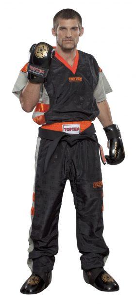 """Kickboksuniform """"NEON Limited"""" voor kinderen Zwart - Oranje"""